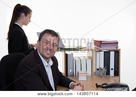 an Happy business man sitting in office