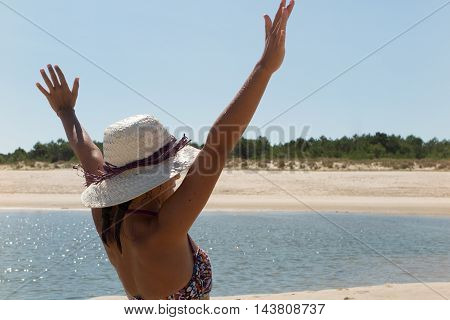 Portrait Of A Happy Joyful Woman Excited And Raising Arms