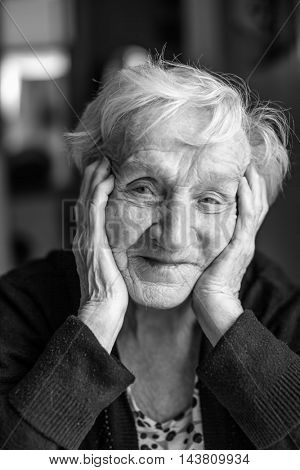 Black and white portrait of an old woman, close-up.