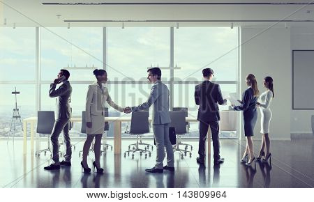 Business people in office  . Mixed media