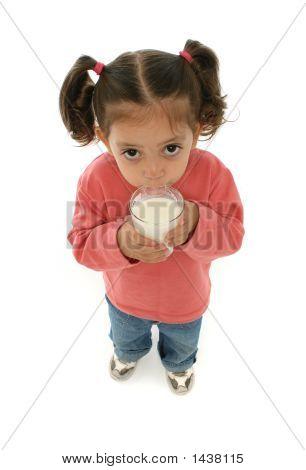Cute Little Girl Drinking Milk