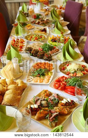 restaurant long table served with snack food and drink for the party