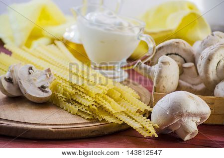 pasta, mushrooms and cream sauce on the table ingredients for cooking