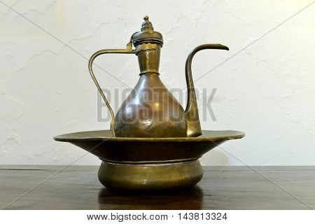 ancient greek wash basin and jug over white wall