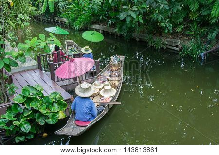 Floating market in Thailand in vintage photo style.