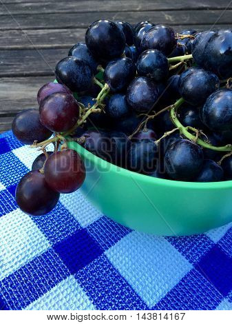 Fresh blue grapes in closeup, selective focus