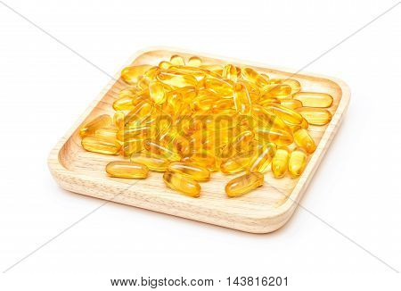 Fish Oil Capsules In Wooden Tray Isolated On White Background