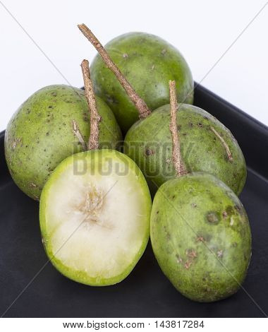 Fresh Hog Plum (wild Mango) On Black Dish