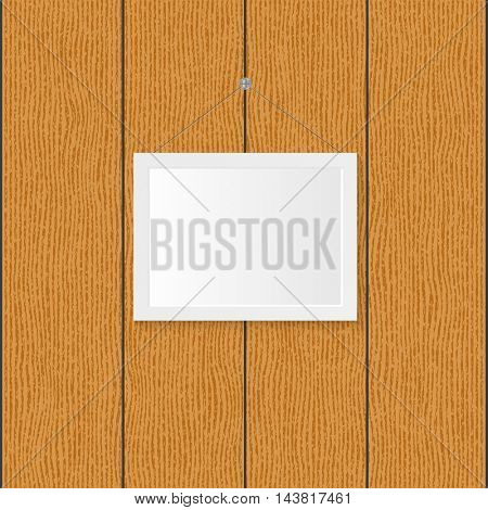 Picture frame on a wood background