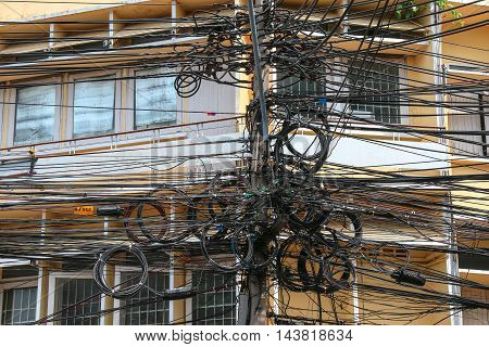 Mess complexity communication wires in Bangkok, Thailand.