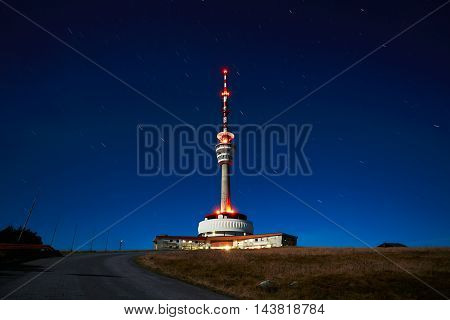 Amazing night view of the TV transmitter with lookout on the top mountain Praded. Famous place in Jeseniky mountains in the Czech Republic.