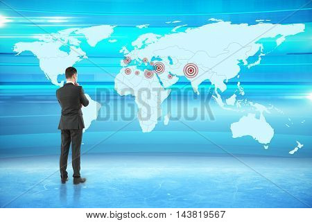 Thoughtful businessman looking at map with targets on abstract blue background. Geo targeting concept. 3D Rendering