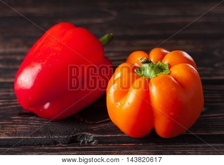 Bulgarian pepper on the wood table. Food background