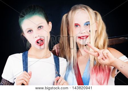 Young Girls with Halloween Makeup. Portrait of Two Children with Artistic Make-up