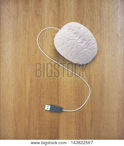 Brainstorming concept with abstract human brain usb plug on wooden surface. 3D Rendering