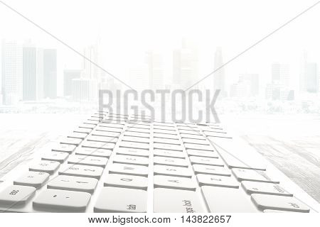 Closeup and side view of white computer keyboard on abstract misty city background. 3D Rendering