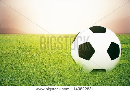 Closeup of football on grass. Abstract background. 3D Rendering