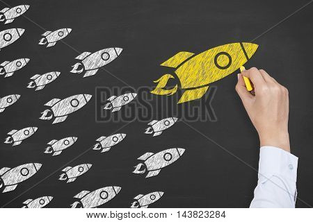 Rocket Leadership Concept on Blackboard Working Businessman Conceptual