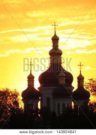 The building of the Orthodox Church against the setting sun