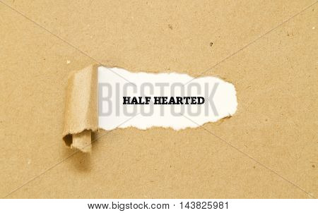 HALF HEARTED word written under torn paper.