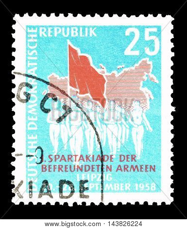 GERMAN DEMOCRATIC REPUBLIC - CIRCA 1925 : Cancelled postage stamp printed by German Democratic Republic, that shows athletes and flag.