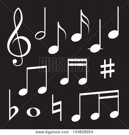Set of musical symbols, white on black background