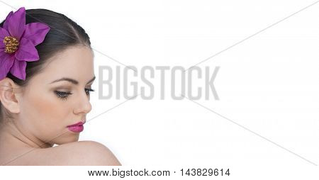 Beautiful face of a young and healthy girl with an orchid purple flower in her hair isolated on white background