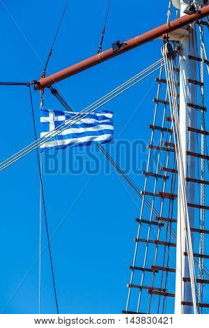 Waving Blue white flag of Greece on boat