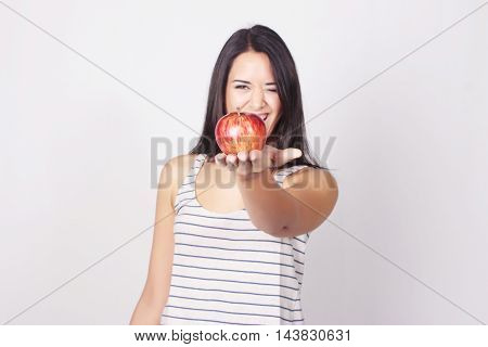 Young Caucasian Woman Holding Apple