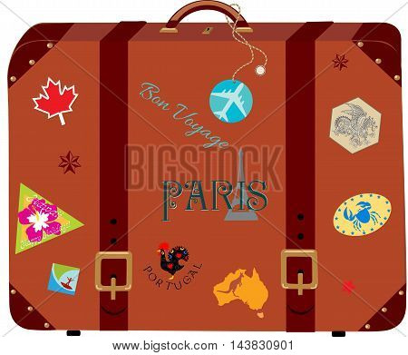 Vintage brown suitcase with the travel stickers from different countries