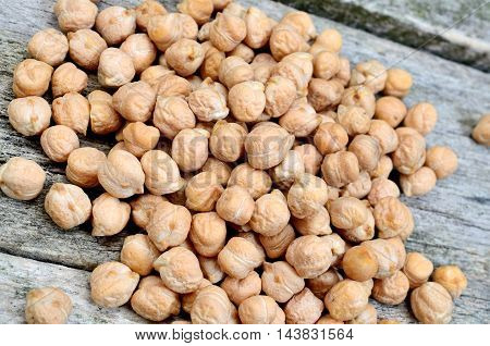 Group of chickpeas on rustic wooden table