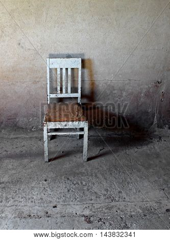 Abandoned old chair in the dark room