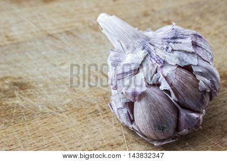 Garlic spice on a wooden table at close up view