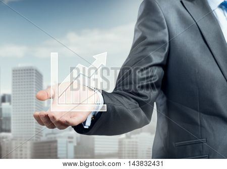 Hand of businessman showing growing graph in palm