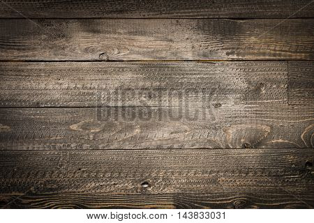 Natural Dark Wooden background. Old dirty wood tables with dramatic light effect