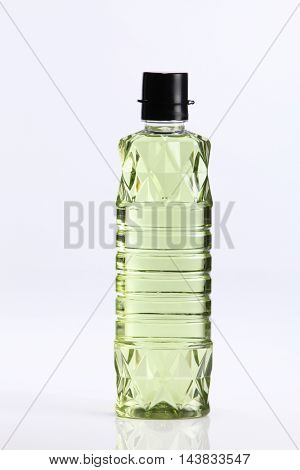 bottle of grape seed oil on the white background