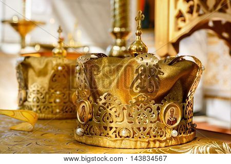 Golden crowns for wedding ceremony in the Orthodox Church. Soft focus selective focus