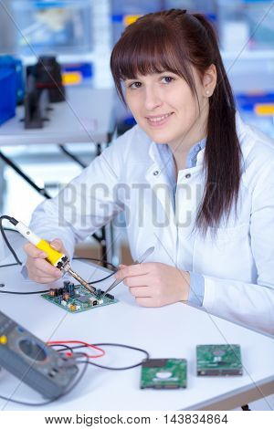 Young woman technician in phisics laboratory