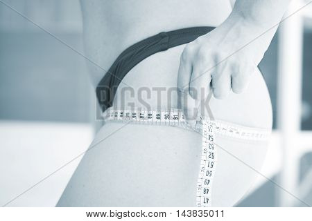 Woman Measuring Waist With Tape