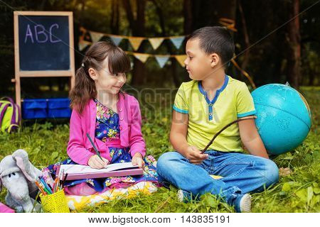 good little children, a boy and a girl studying together. Education and school concept.