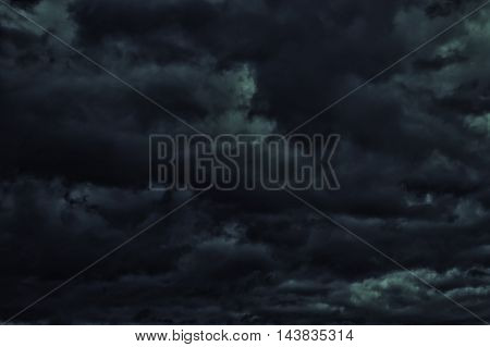black and gray background with thunder clouds