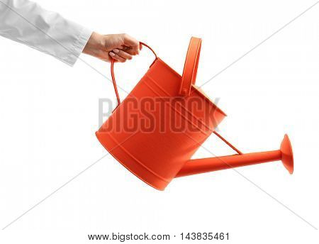 Hand holding watering can isolated on white
