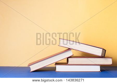Stack of colorful books on table. Education background. Back to school. Copy space for text