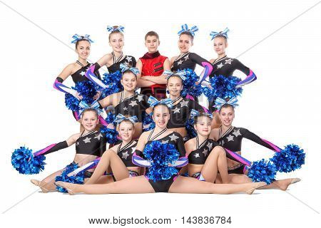 Dneprodzerzhinsk Ukraine - February 13 2016: team of young professional cheerleaders posing in the studio for a group photo