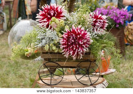 fresh flowers in a small decorative trolley
