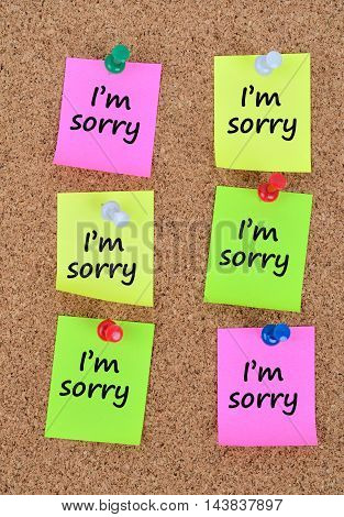 The words I'm sorry on colorful notes