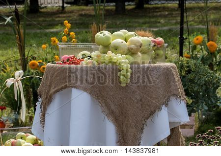 harvest of fresh ripe apples and grapes on the table