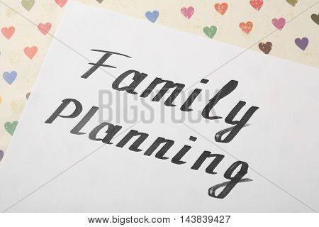 Paper sheet with words Family planning, close up