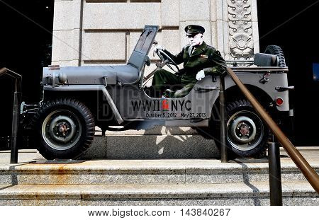 NYC - May 11 2013: A cut-out of General Dwight D. Eisenhower sitting in a jeep promotes the WWII & NYC exhibition at the New York Historical Society Museum