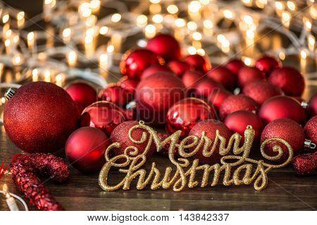 Merry Christmas text against Christmas decoration